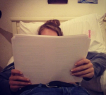 AJ reading in bed